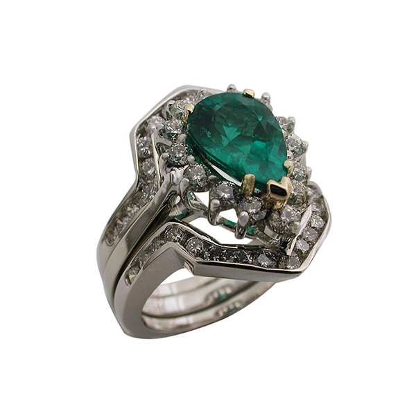 Emerald and Diamond Engagement Ring with Matching Diamond Guard-style Wedding Band.