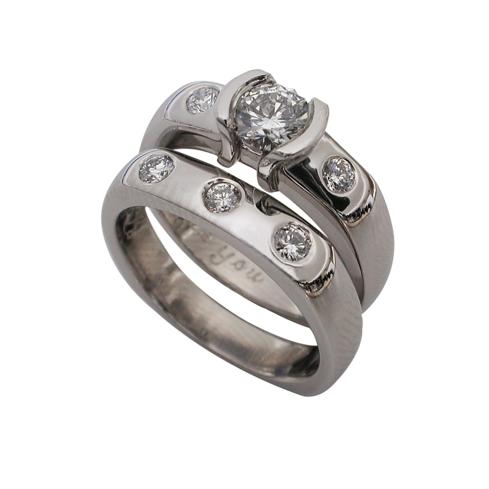 Platinum Round Brilliant Diamond Half Bezel Ring Shown with Matching Wedding Band
