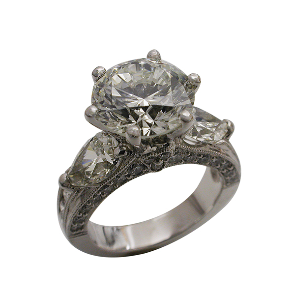 Platinum Round Brilliant & Pear Shaped Diamond Ring
